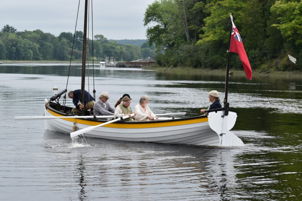 REENACTORS ROWING A JOLLY BOAT IN THE KENNEBEC RIVER